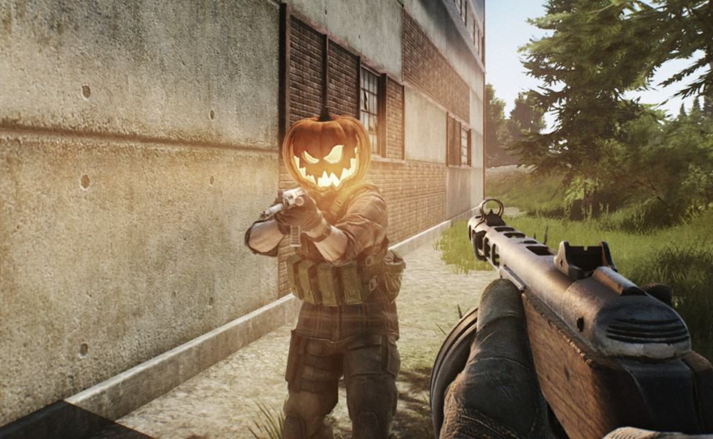 Escape from Tarkov (EFT) Two players pointing guns at each other. One has a pumpkin head skin.